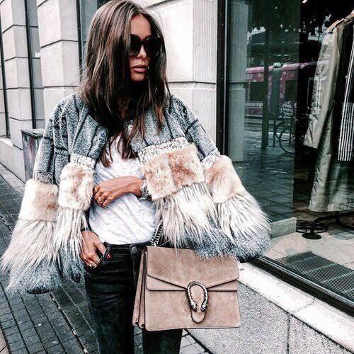 A fur coat. Every day of the week. Every season. (And preferably faux)