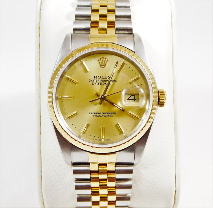 18k Gold and Stainless Men's 2-Tone Oyster Perpetual DateJust--A classic symbol of status.  This luxury timepiece is in near mint condition and is available at Edberg Jewelry.