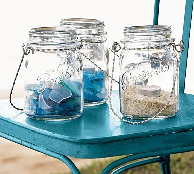 Jars with sea glass or sand with candles