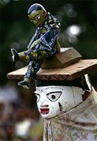 Masks illustrate well-known cautionary Yoruba proverbs.
