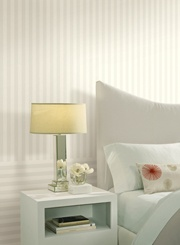 Hang striped wallpaper vertical AND horizontal to create interest to your space.