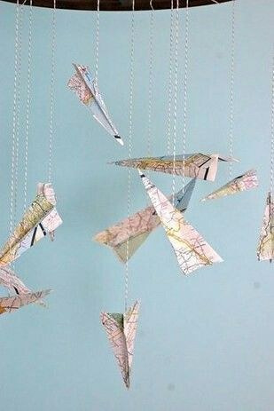 Paper airplane mobile made from maps.