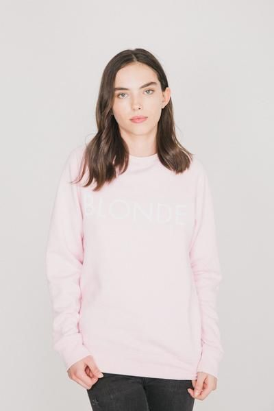 Our BLONDE crew neck sweater is now available in pretty pink with white font. We fit cozy. Fibre Content: 52% Polyester 48% Cotton,modeled in size S/M. -Designedin Canada