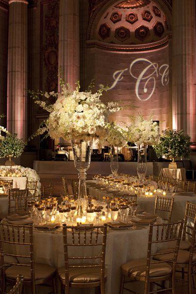 tall centerpieces with lit monogram #wedding