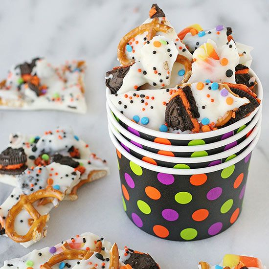 This Halloween Candy Bark is both smooth and crunchy, sweet and a bit salty -- and you won't believe how easy it is to make! This is a perfect treat to serve at a party or package up as little gifts or party favors.