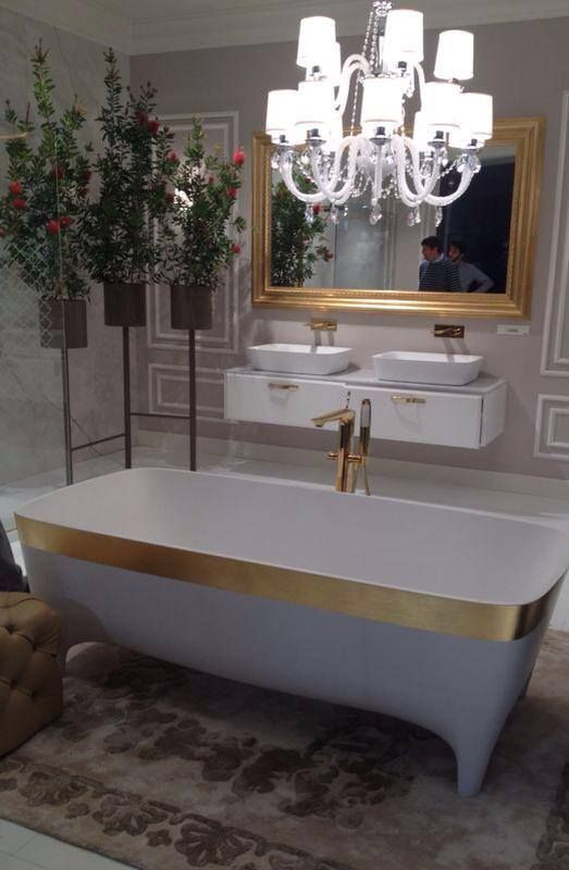 Directly from Salone del Mobile in #Milan golden Accademia #bathtub. For a luxury elegant #bathroom. Love the chandelier ;)