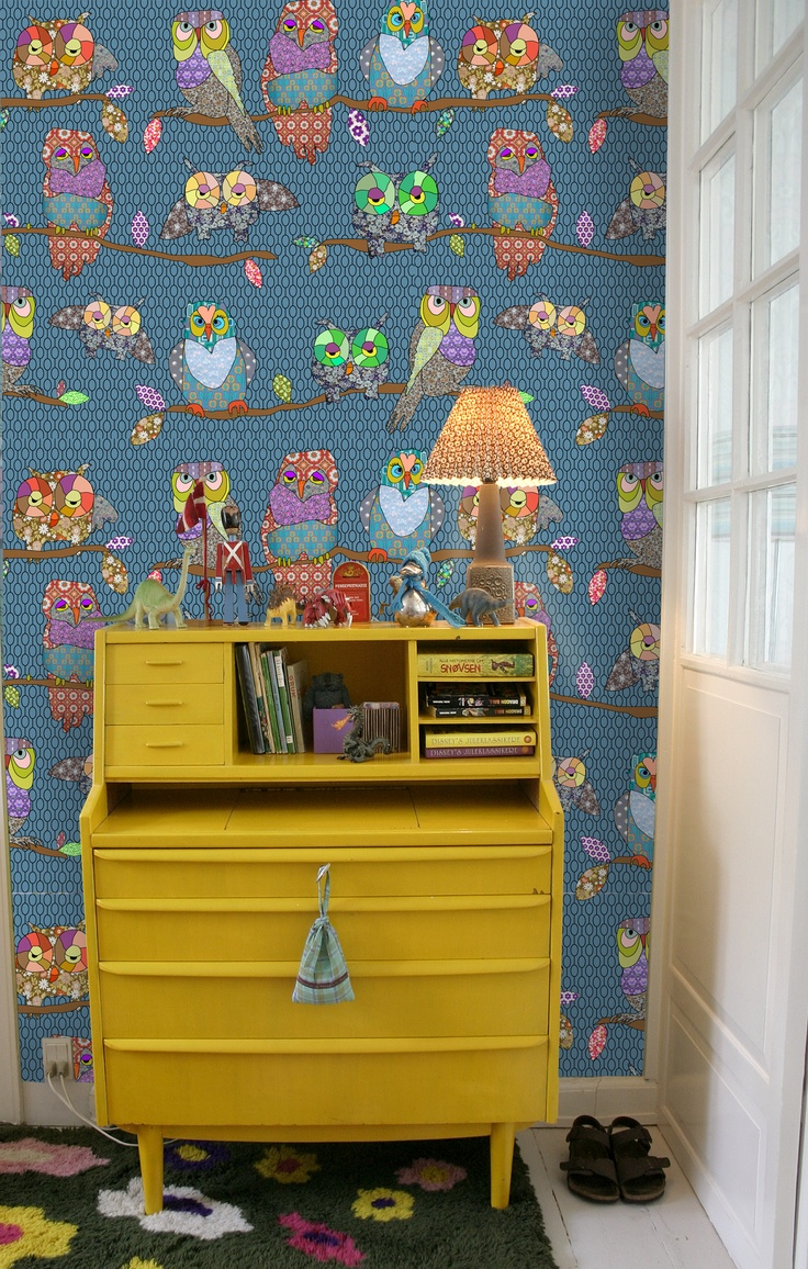 Beautiful yellow dresser with Andrea Larsson wallpaper in the back...