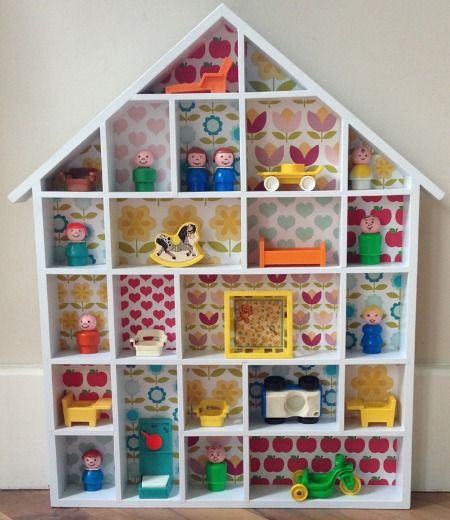 Vintage fisher price toys. Love the wall paper backing