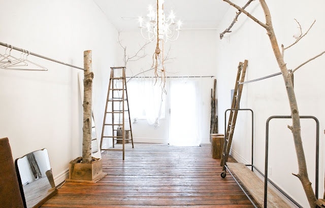 Just add the clothing. Tree branches to end hanging rods. Lovely idea for merchandising and pop-up décor! PopUpRepublic.com