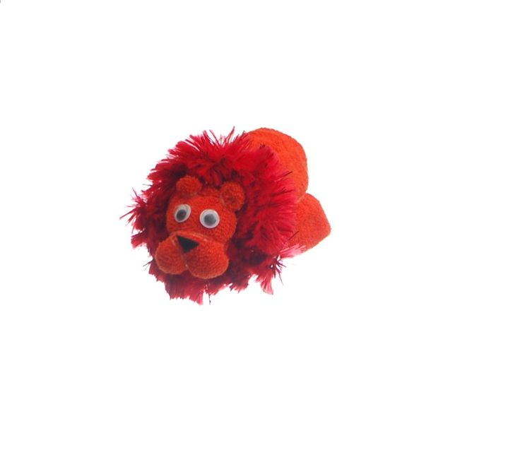 Lion towel art - Baby washcloth lion made from two orange baby washcloths. A perfect creation for a baby shower gift or to put on top of a jungle nappy cake. Perfect for a baby boy gift, baby girl gift or unisex baby gift.
