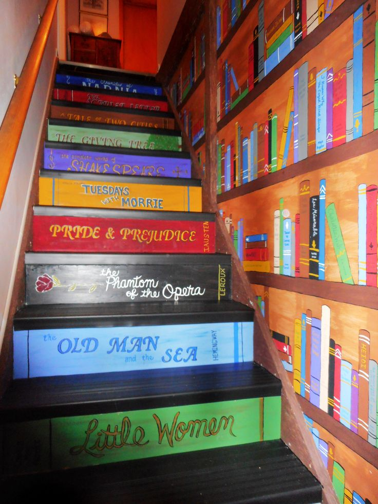 "Library Stairway- I first saw the idea for book staircase on Pintrest, then decided to take it all the way by also painting books on the wall and adding the ""library-esque"" stair treads. Each of us also made up a title if we were to write a book about our life. We added these titles with names and the year amid the books on the wall. It took some time to do and lots of patience, but we are thrilled with how it turned out. Thanks for the inspiration Pinterest!"