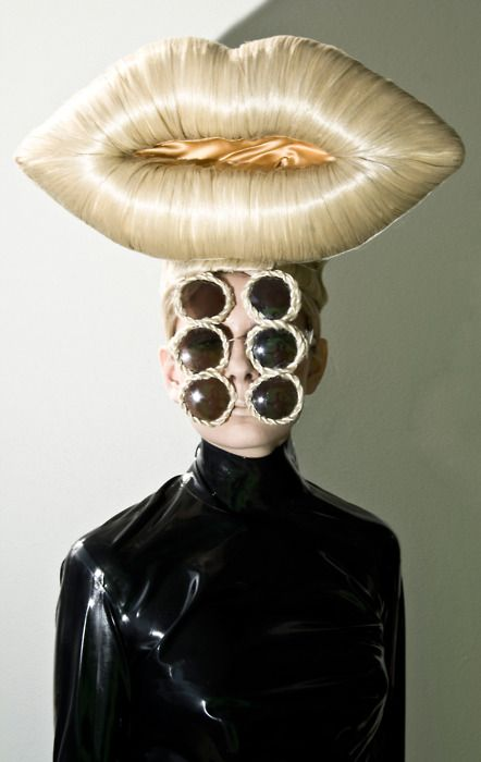 If you need all these glasses...well, ...and the hat...do we not wonder whether some designers want to see how silly they can make women look?
