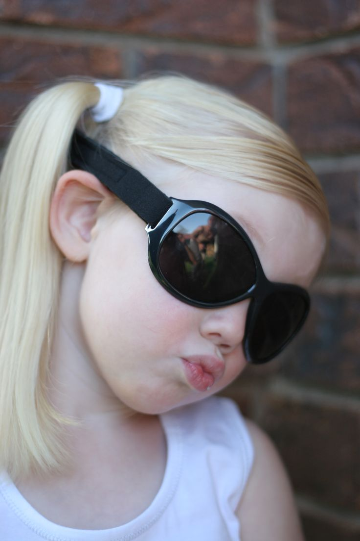 Adorable in her Retro Banz sunglasses in 'Midnight Black' - the comfy headband's adjustable, so they'll last until she's well over five!