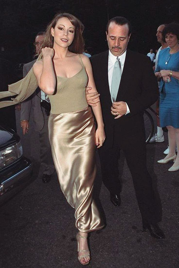 90s Style File: Mariah Carey #refinery29 http://www.refinery29.uk/90s-mariah-carey-style-glitter-butterfly#slide-1 Mariah Carey and her ex-husband Tommy Mottola pre-divorce, obvi. Mariah's golden silk column skirt and twin-set cami and cardi are the stuff of every '90s girl's dreams. ...