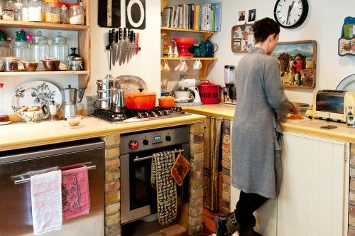 Cozy Brit kitchen part 2...the mix of modern appliances with weathered brick and vintage finds appeals to me.