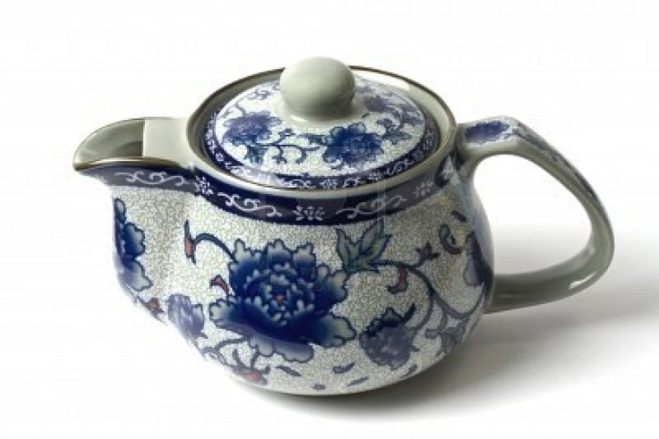 I love my collection of quaint Chinese tea kettles!