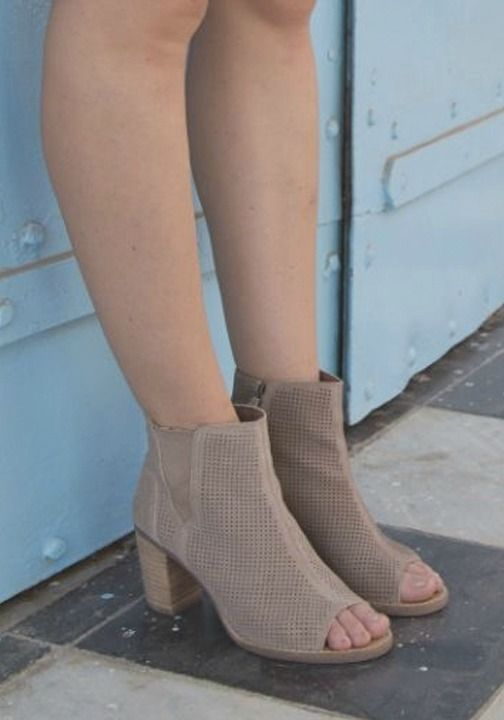 This spring, style meets comfort with the new arrival of peep toe booties. Hit the streets in style with the latest fashion trends.