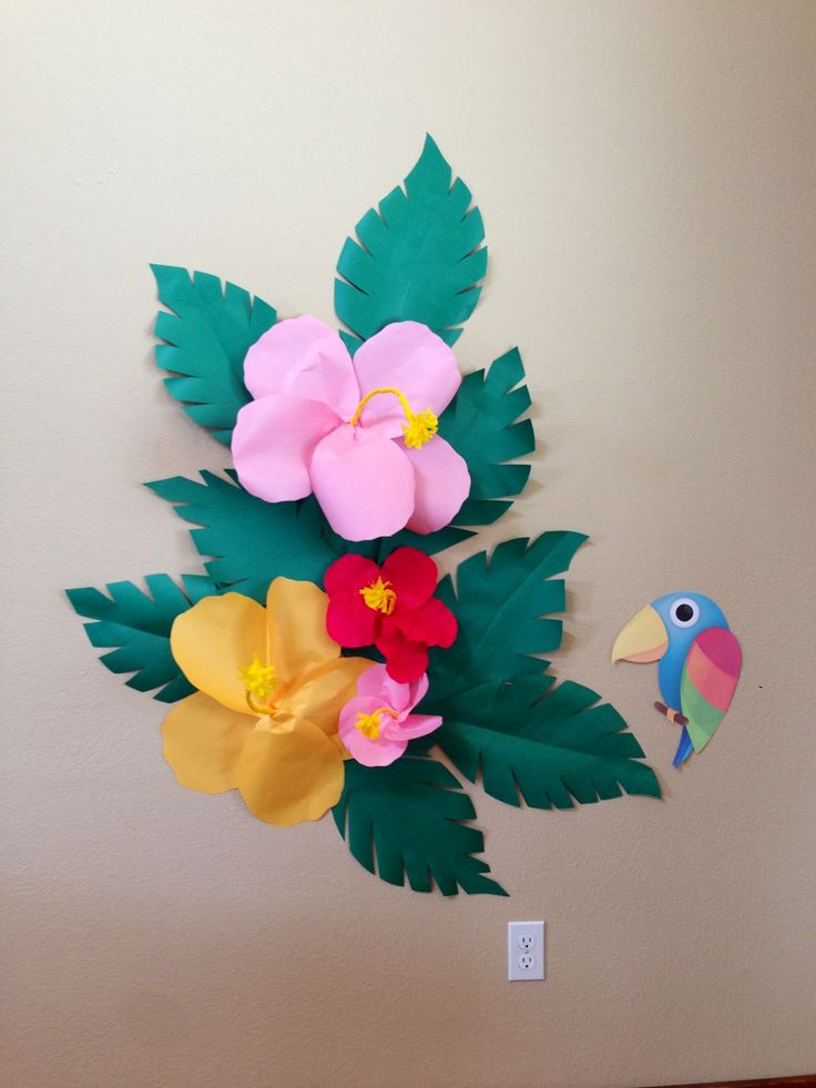 DIY 3D giant paper hibiscus backdrop for photos and pin the beak on the parrot game at my daughter's luau party