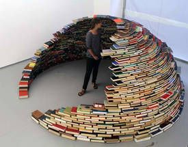 """Home,"" an installation at NYC's MagnanMetz Gallery by Colombian artist Miler Lagos is a stable igloo made of carefully stacked books."