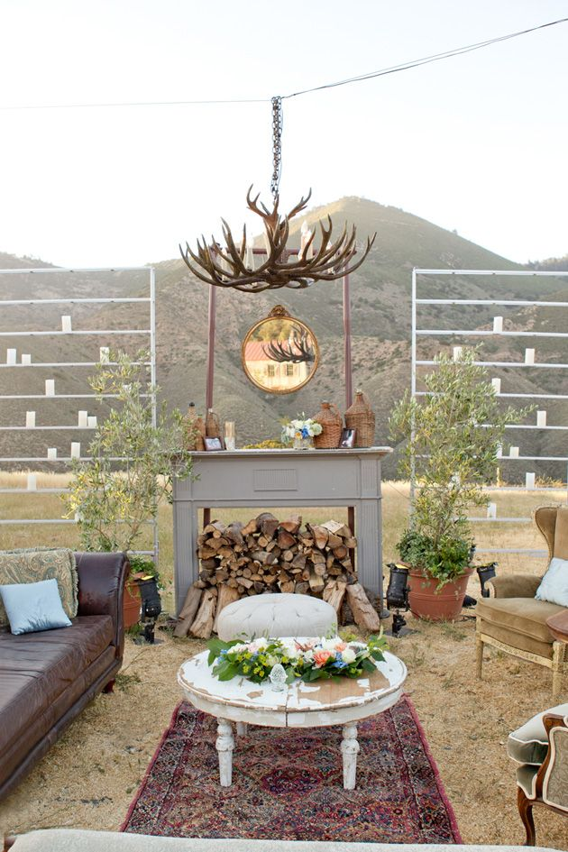 ❤ bohemian lounge for an outdoor wedding ❤ LOVE the arrangement if not the style....Fireplace, chandelier, sofas, tables, & 'shelves' lined with candles & a few plants scattered about ❤ lovely