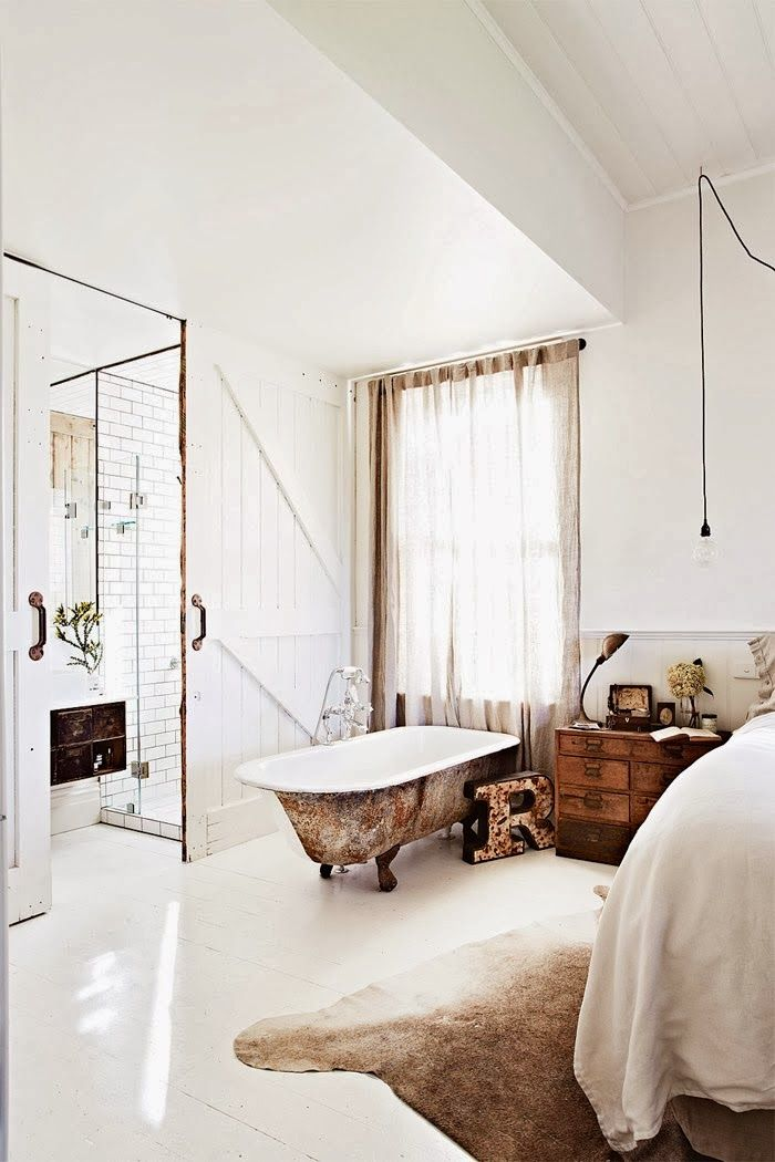 love the idea of a bath in my bedroom. The perfect space for a Sunday lie-in