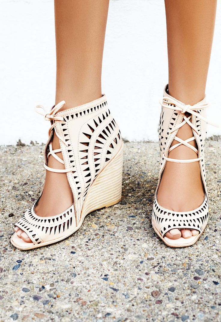 Laser cut leather wedges featuring an open toe, adjustable lace-up detailing and a stacked wedge. // Free People beachy boho heels