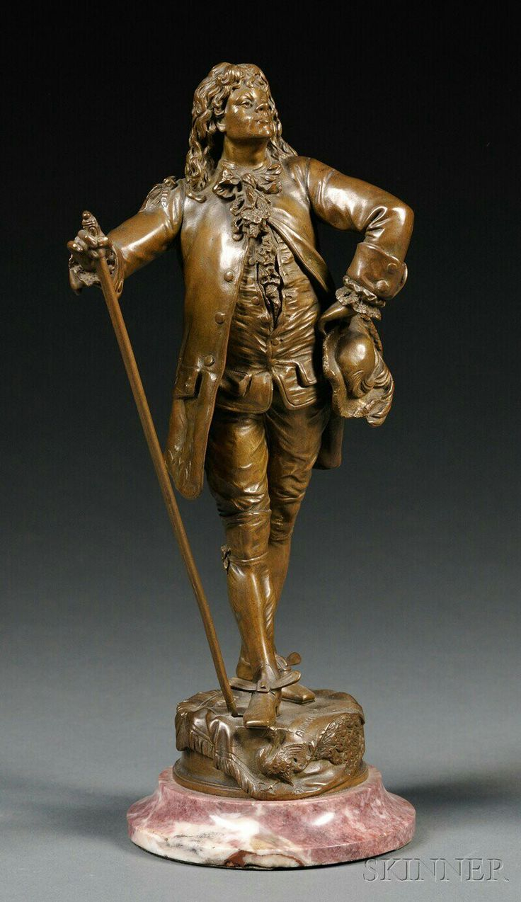 Bronze Figure of Le Bourgeois Gentilhomme Molière,  brown patina, the top of the base titled and signed E. Piccault, the side inscribed Boyer Freres a Paris, on circular rouge marble base, bronze ht. 10 1/4 in.