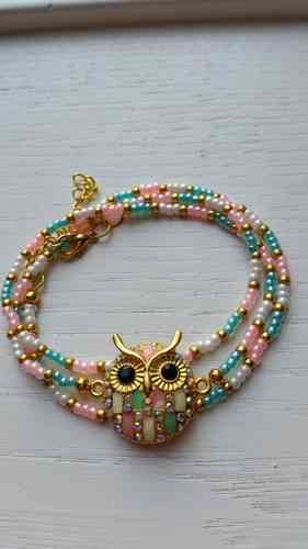 Bracelet with owl and pink, green en golden beads