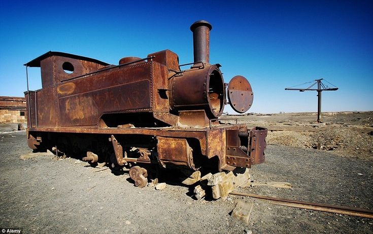 An old train stands abandoned on rusty tracks in Humberstone. The town was declared a national monument by the Chilean government in 1970 and became a Unesco World Heritage Site in 2005