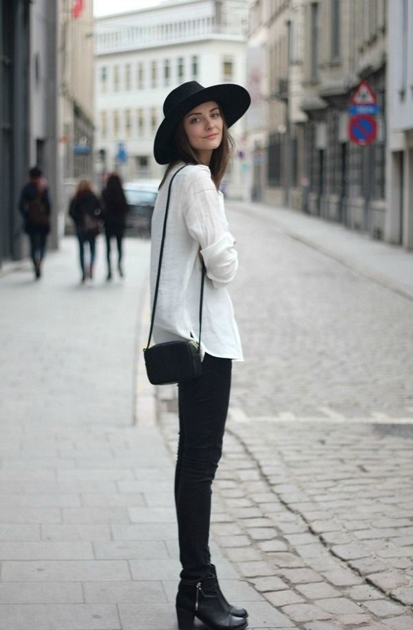 black brimmed hat, white linen shirt, black cross body bag, black skinny jeans, black booties