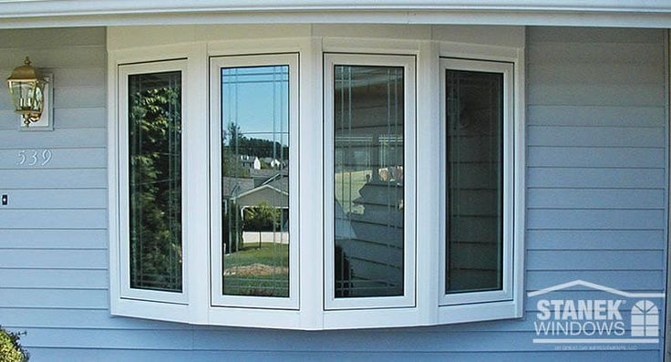 White, four-lite bow window with overhang tie-in and casement windows with double prairie custom groove etching. Learn more.