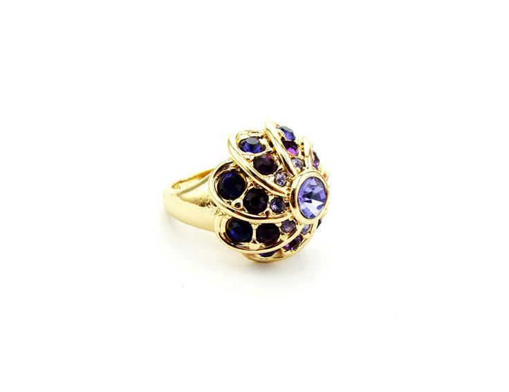 "Stefanie. Floral design of gold metal colour with purple rhinestones. Lightweight. Band width:0.5cm(.2"") - 1.5cm(.6"") . Décor diameter: 2cm(.8"") ."