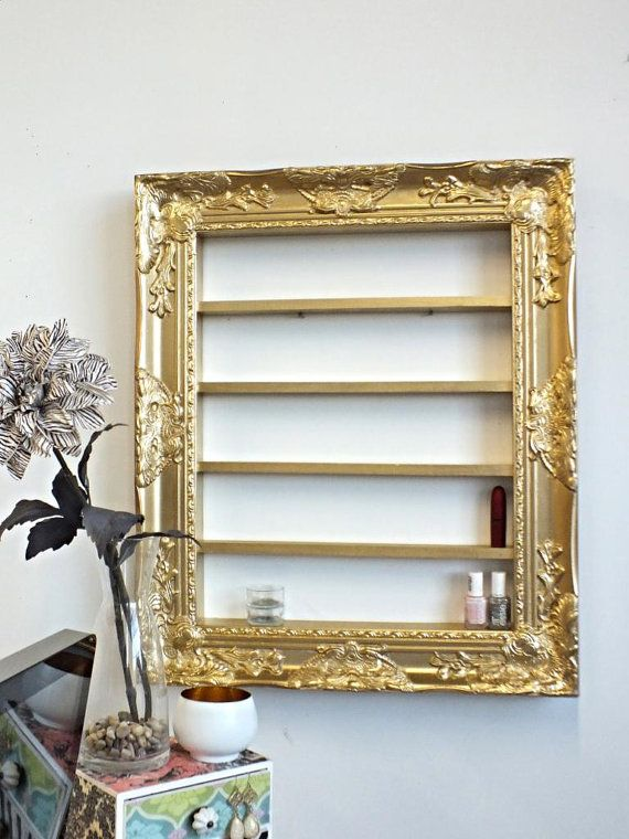 Gold Baroque 16x20 frame display by DaintyCreations on Etsy, $100.00  organizes make up and some jewelry. Great for nail salons