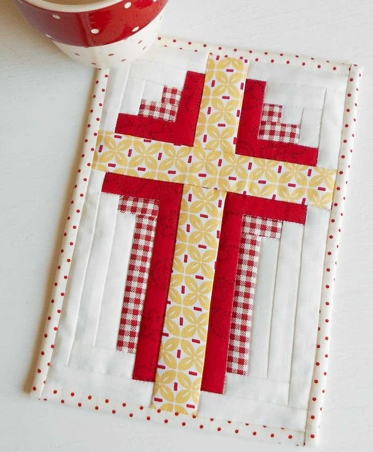 Log Cabin Cross Mug Rug.  Place it on your table or hang it on the wall (pattern includes instructions for quick hanging corners).