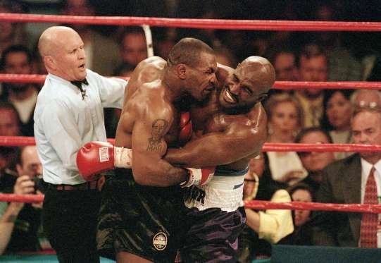 Heavyweight Bout, June 28, 1997 | Mike Tyson bites the ear of Evander Holyfield during their 1997 he... - V.J. Lovero