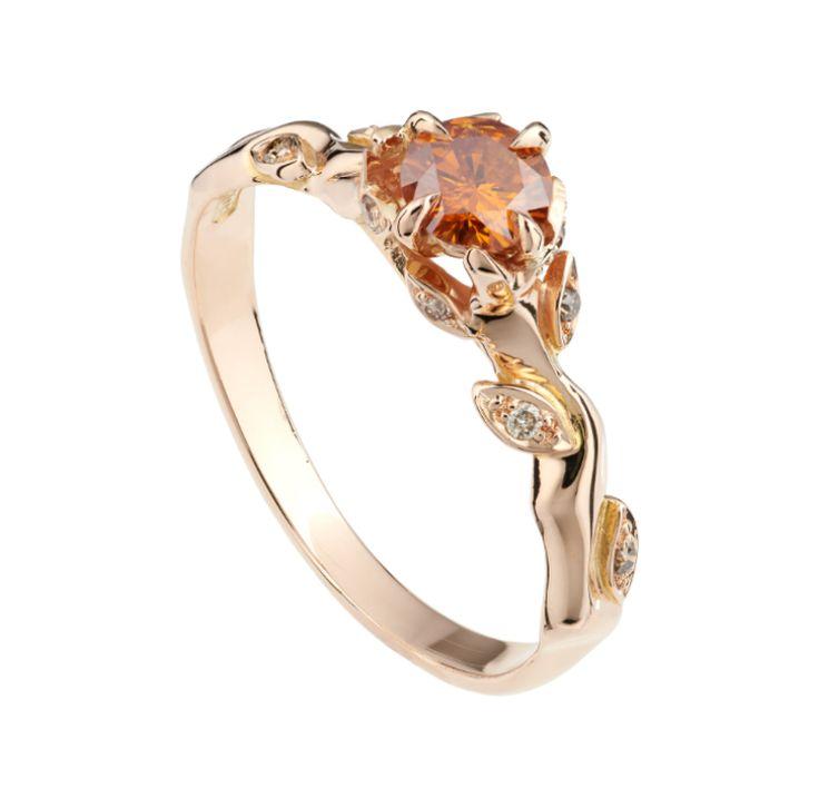 Orange diamond rose and thorn ring