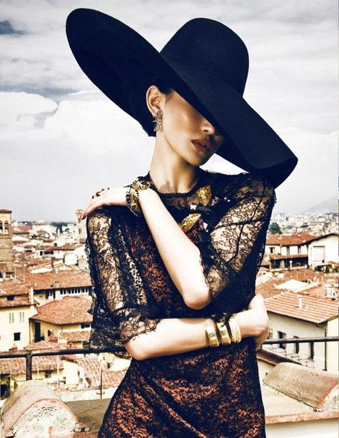 Timeless Elegance: Channel your inner Italian primadonna. Loving that hat and the black lace with thick rich gold bangles - the perfect contrast to the azure blue dropdead gorgeous coast of Amalfi.