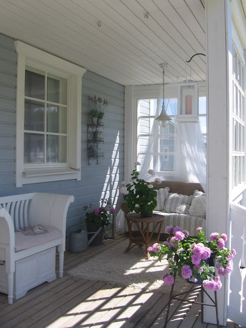 Peaceful blue and white porch. Love this!