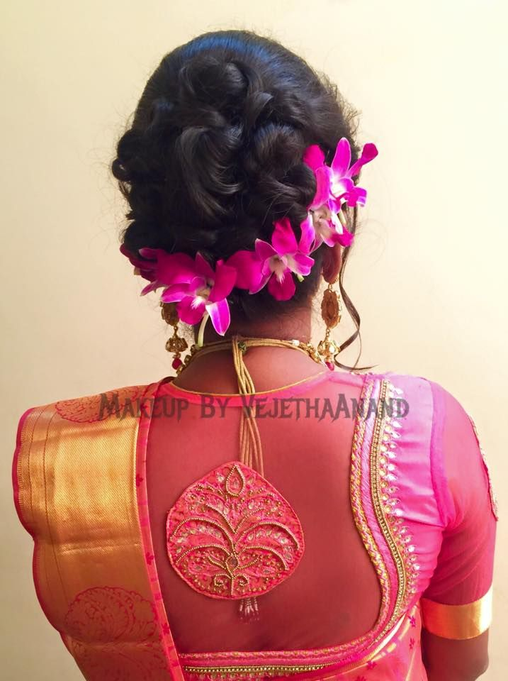 Indian bride's bridal reception hairstyle by Vejetha for Swank Studio. #Saree #Blouse #Design #HairAccessory #orchids #laceblouse #sariblouse Tamil bride. Telugu bride. Kannada bride. Hindu bride. Malayalee bride. Find us at https://www.facebook.com/SwankStudioBangalore