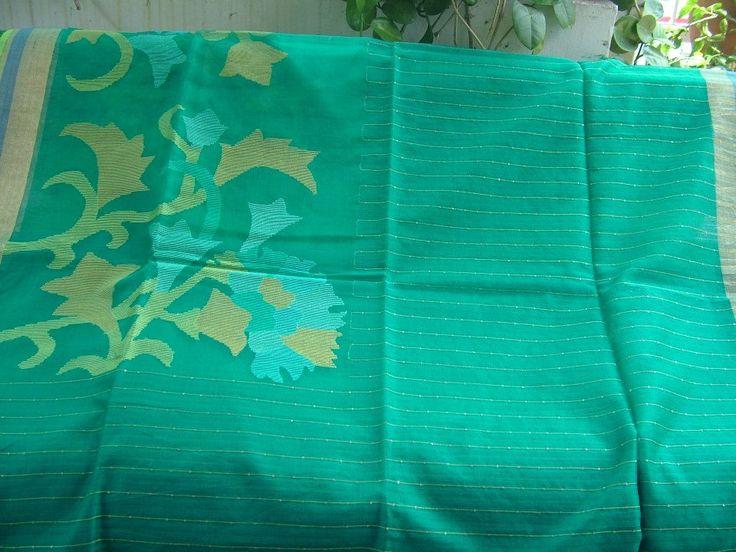 Byloom | Sari name: Bahari Green; Material: Silk with sequins and a jamdani motif skirt border; Price: Rs 7500