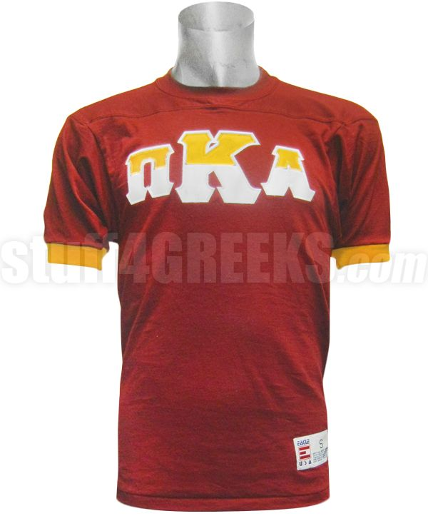 cardinal red pi kappa alpha crossing jersey with gold cuffs and split color greek letters across