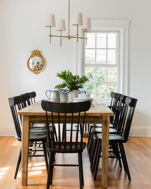 Gorgeous Eclectic Dining Room With Metal Table Oak Top Glossy Black Salt Chairs Brass Chandelier White Shaker Kitchen Cabinets And