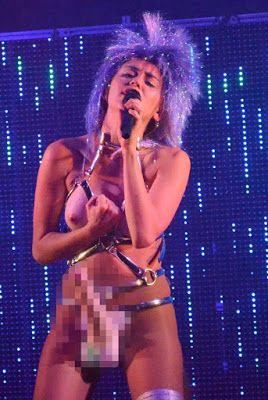Welcome to Maureen Sylvia's Blog: Miley Cyrus performs topless while wearing a strap...