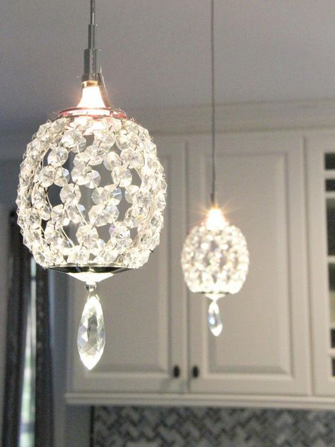 Crystal pendant lights over a peninsula bring a touch of glam to this transitional kitchen.