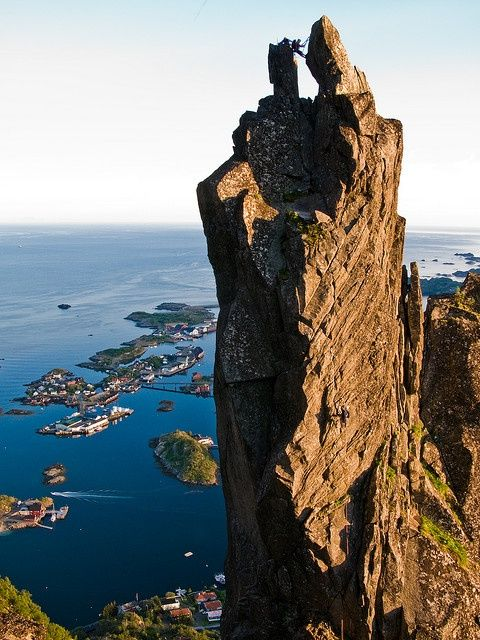 Svolvaer, Lofoten in the north of Norway. I hafta rough it like this dude in the pic! I wanna rock climb this rock!!!