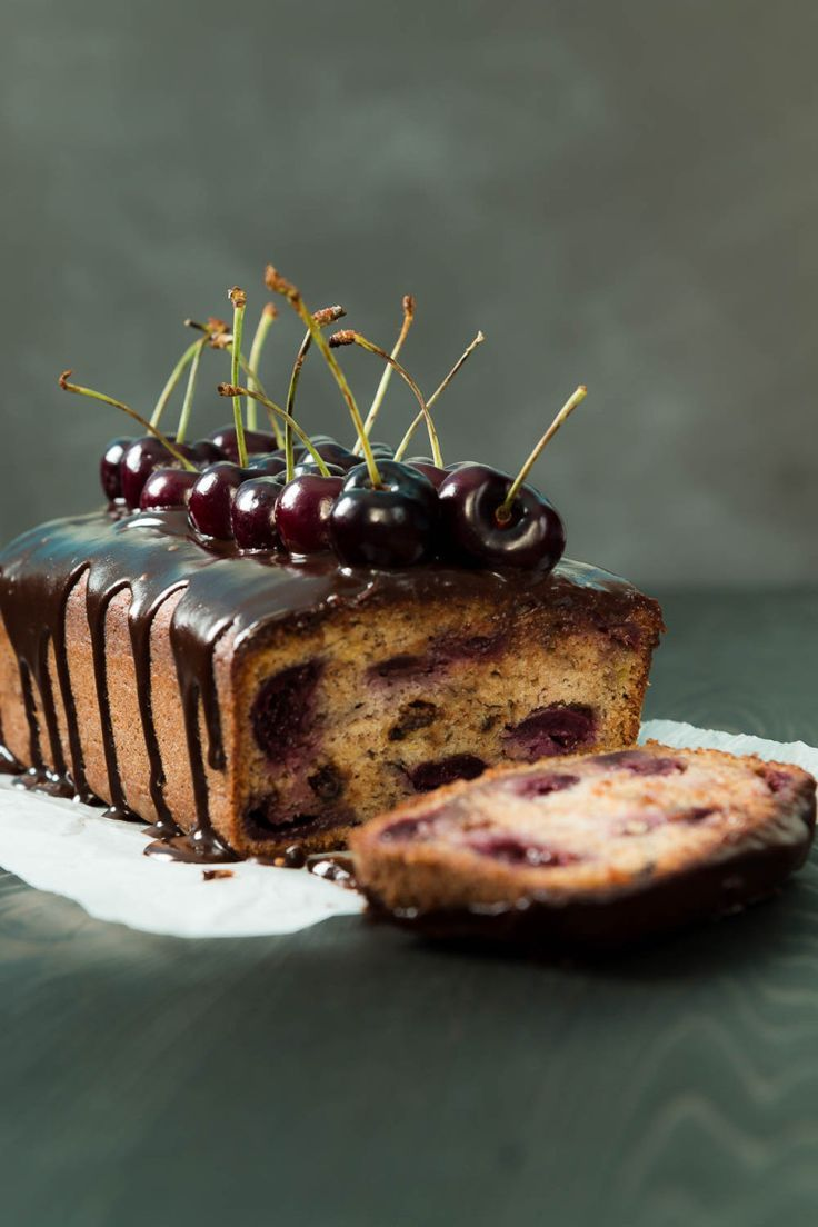 Chocolate Cherry Banana Bread full of juicy cherries & covered with a honey chocolate drizzle.