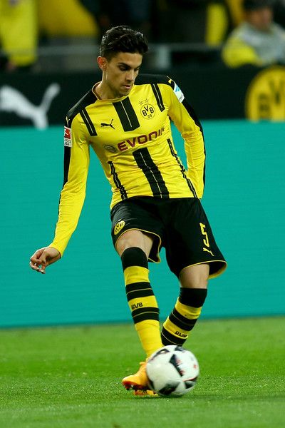Marc Bartra of Dortmund runs with the ball during the Bundesliga match between Borussia Dortmund and Hamburger SV at Signal Iduna Park on April 4, 2017 in Dortmund, Germany.