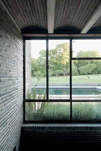 CHARLES PICTET ARCHITECTE FAS | SIA stone brick modular windows
