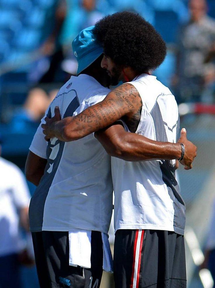 Carolina Panthers quarterback Joe Webb, left, embraces San Francisco 49ers…