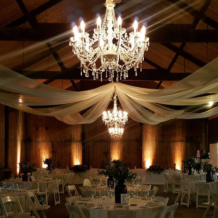 Classic drapes and chandeliers are a gorgeous contrast to a rustic wedding at Glen Ewin Estate. Lush Lighting- Adelaide